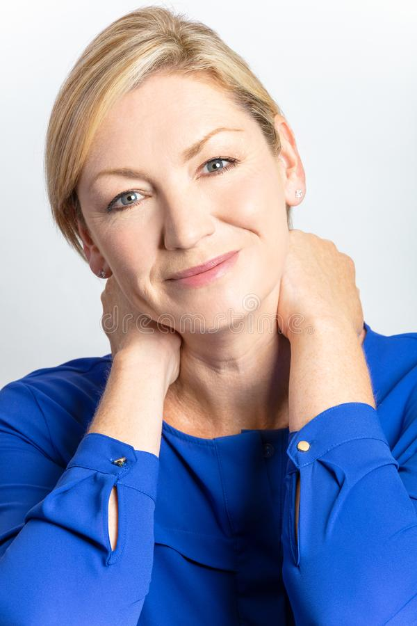 Studio Portrait of Healthy Happy Middle Aged Woman royalty free stock photos
