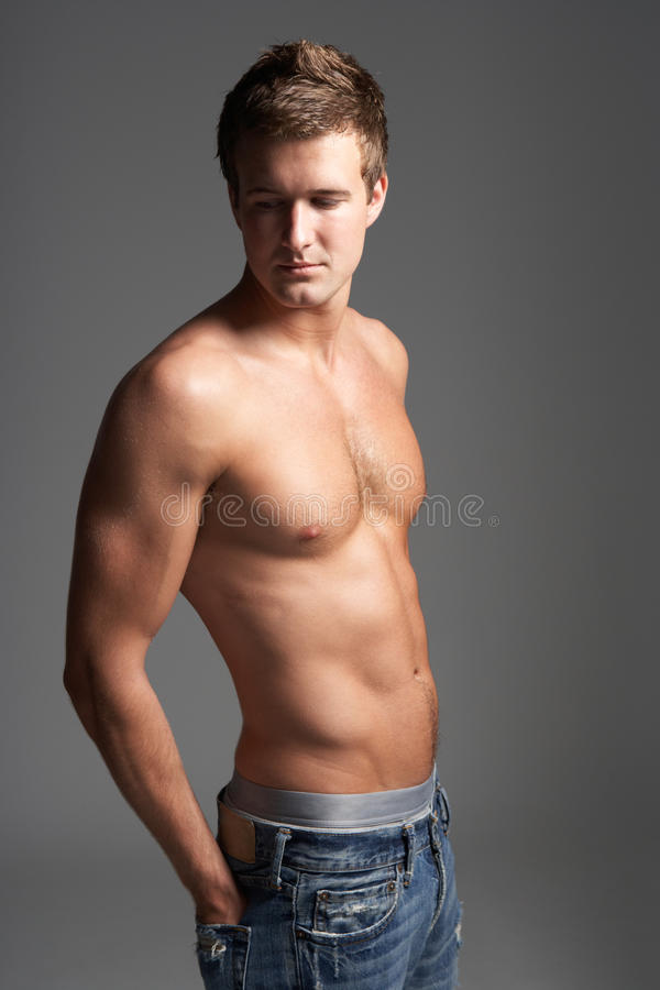 Studio Portrait Of Bare Chested Muscular Young Man royalty free stock photo