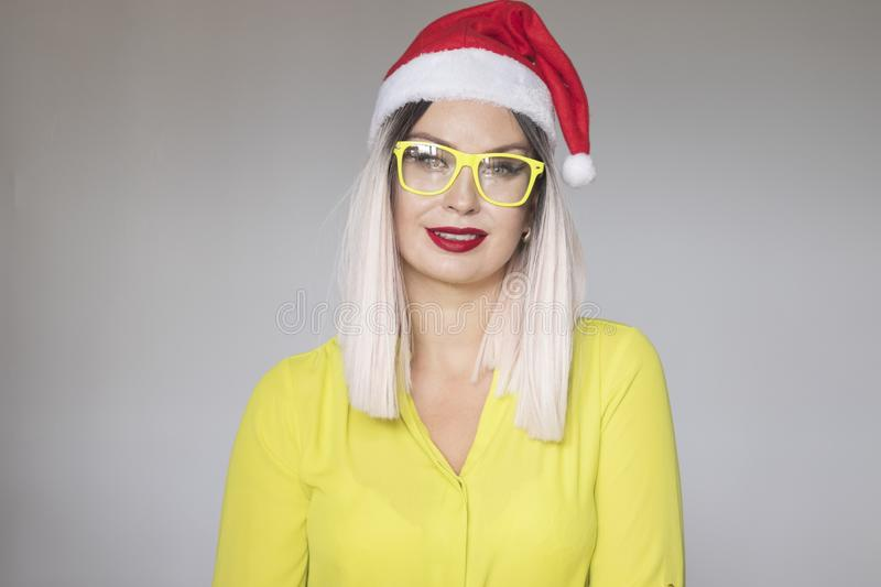 Studio portrait of a beautiful blonde woman wearing christmas red hat stock photo