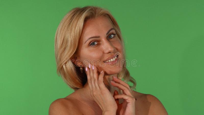 Studio portrait of a beautiful mature woman touching her face sensually stock photos