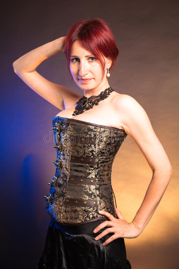 Studio Portrait of a beautiful steampunk woman stock images