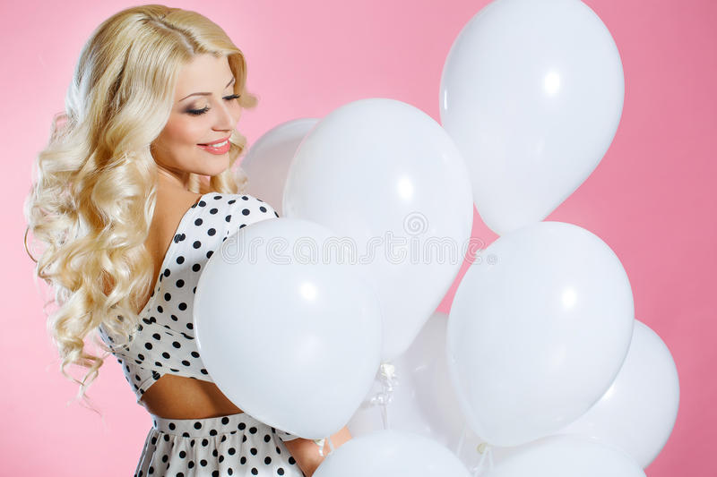 Studio portrait of the beautiful woman with balloons royalty free stock photos