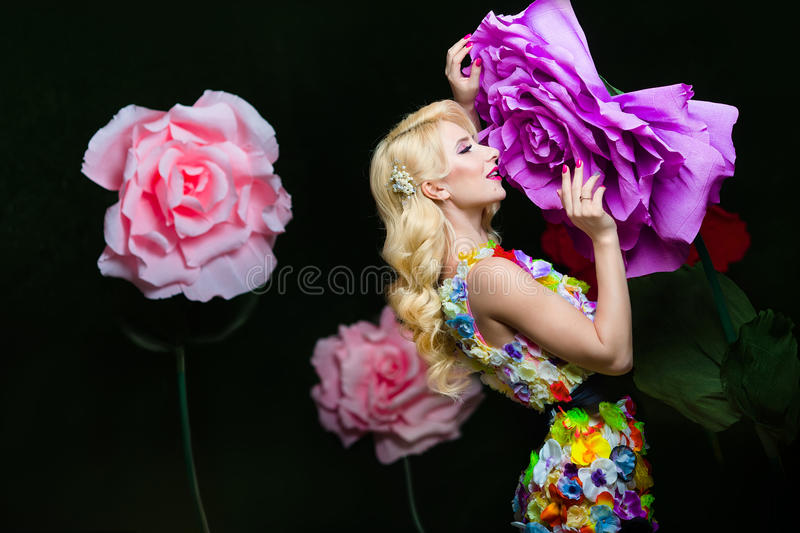 Studio portrait of blooming gorgeous lady in dress of flowers stock photos