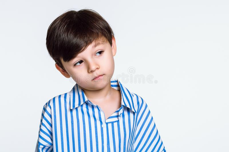 Studio portrait of a boy who is disappointed because he does not get what he wants stock photos