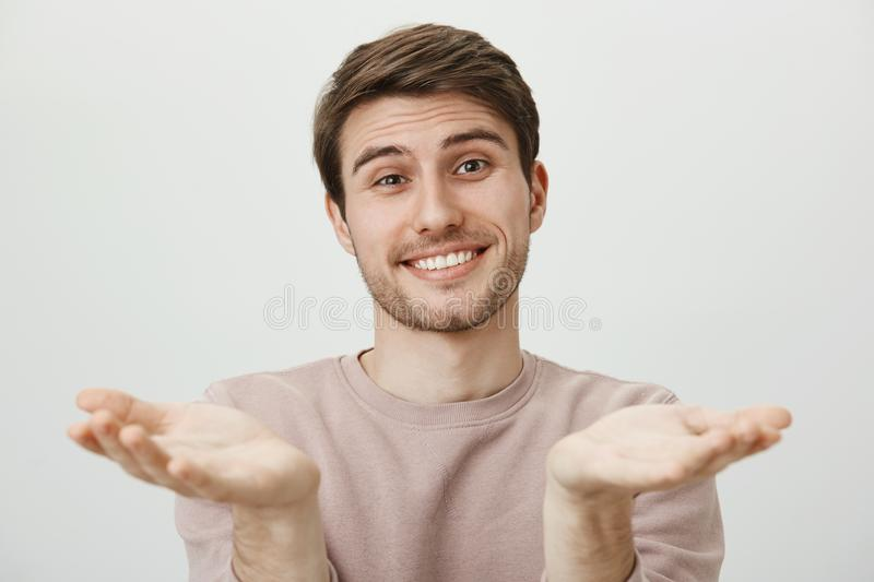 Studio portrait of cute good-looking european male coworker pulling palms towards camera as if begging for favour or. Congratulating friend who achieved a lot royalty free stock image