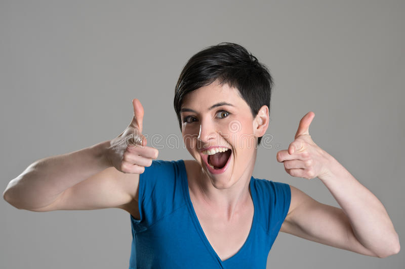 Studio portrait of excited energetic brunette beauty pointing finger towards camera stock images