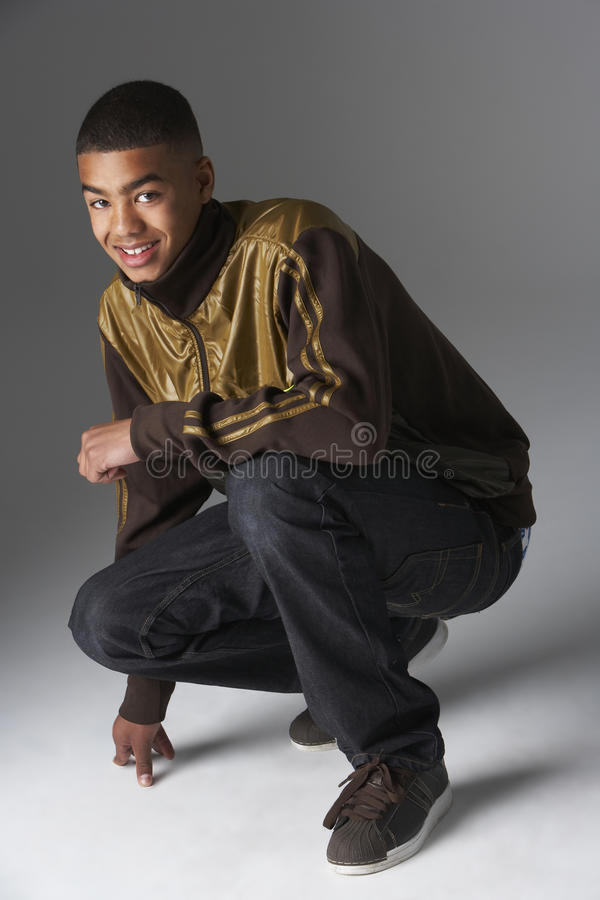 Studio Portrait Of Fashionably Dressed Teenage Boy Stock Image