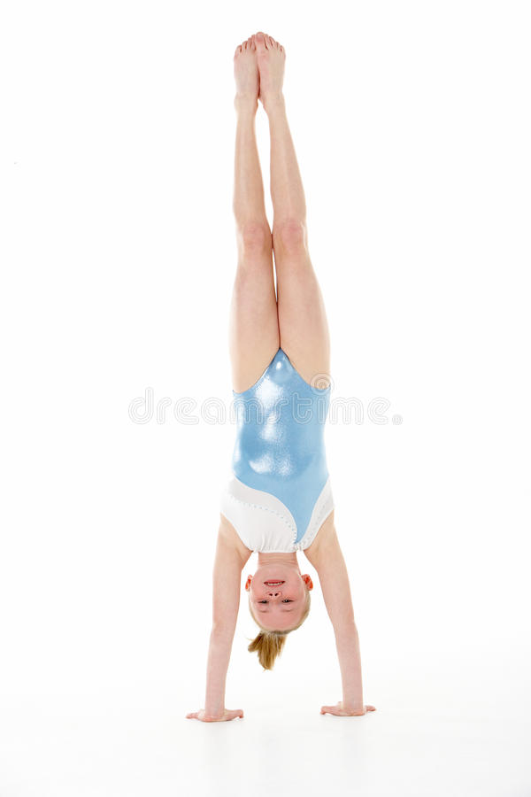 Studio Portrait Of Female Gymnast Doing Handstand royalty free stock image