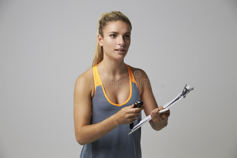 Studio Portrait Of Female Sports Coach With Clipboard stock image
