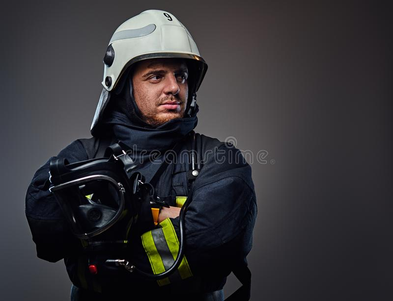 Studio portrait of firefighter dressed in uniform. royalty free stock photo