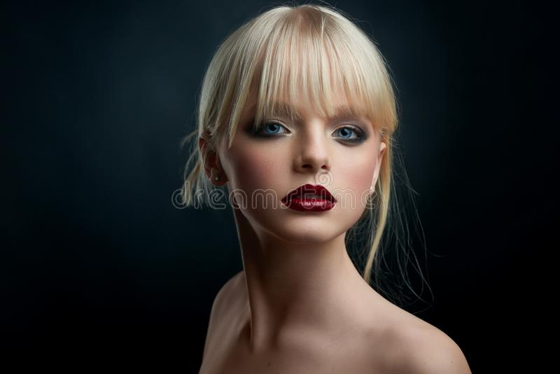 Studio portrait of a girl with evening make up. stock photography