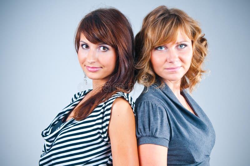 Studio portrait of girlfriends stock images