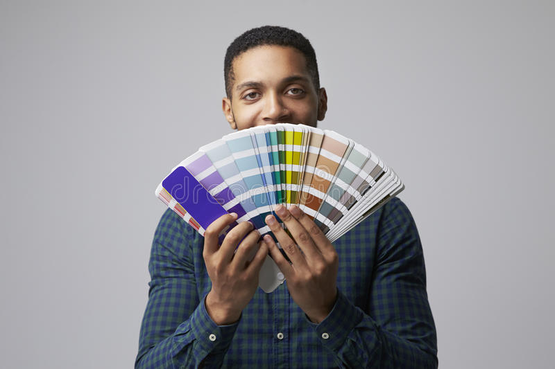 Studio Portrait Of Graphic Designer With Color Swatches royalty free stock photos