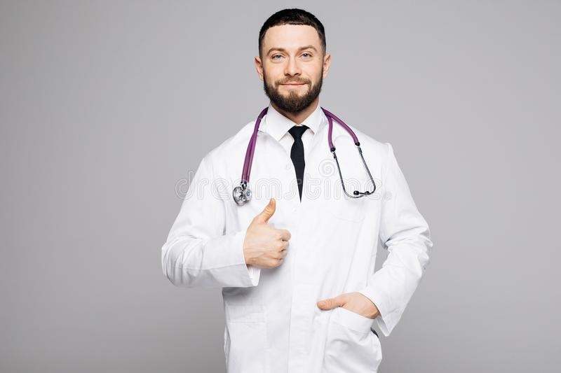 Portrait of a handsome cheerful male doctor smiling happily showing thumbs up copyspace on the side stock images