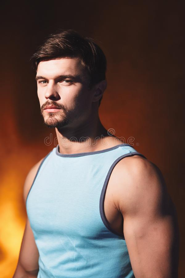 Handsome muscular man posing in studio. stock photography