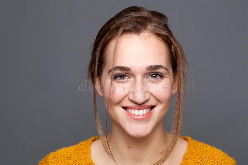 Studio portrait of happy, natural glowing beautiful woman expressing wellness stock images