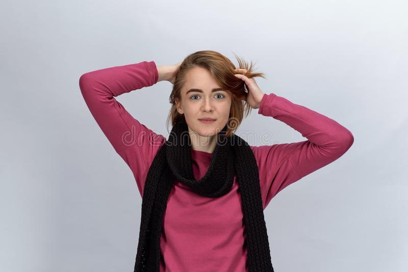 Studio portrait joyful attractive red-haired girl dressed in a s royalty free stock image