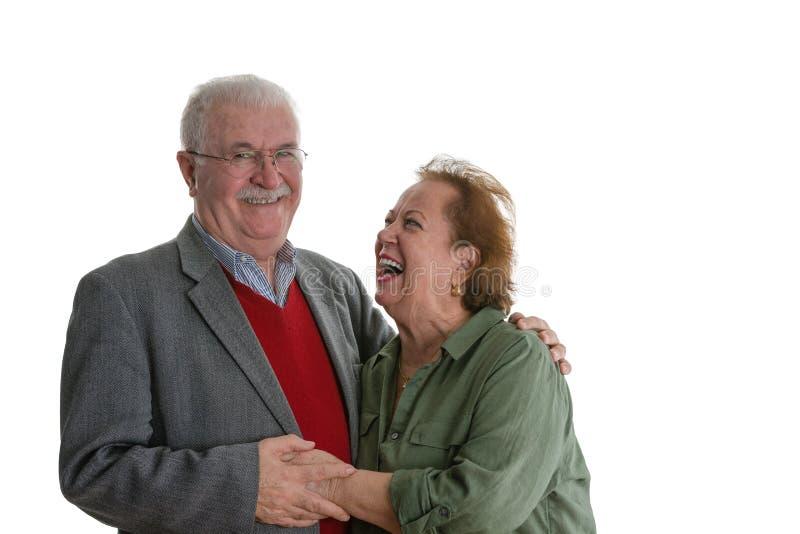 Studio portrait of laughing elderly couple royalty free stock photo