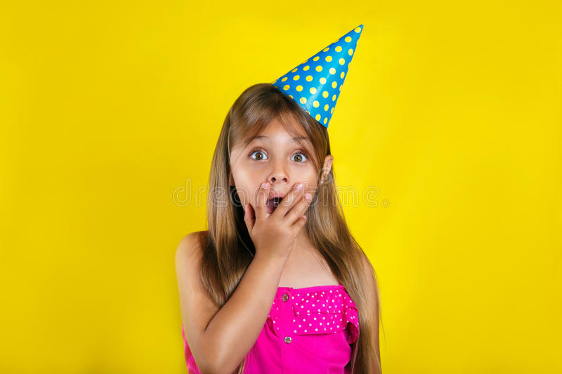Studio portrait of a little girl wearing a party hat on her birthday. Cute girl Having fun stock photos