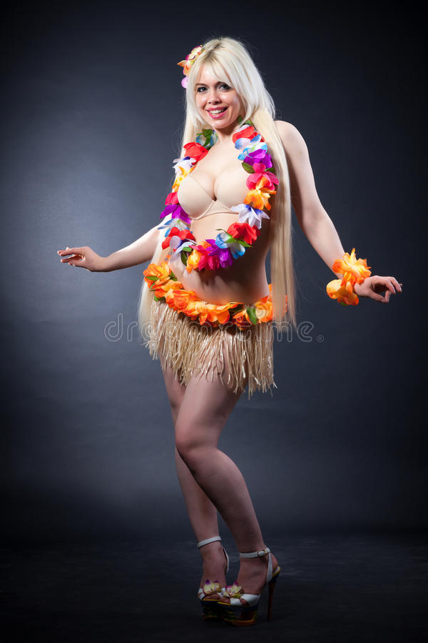 Studio portrait of lovely girl in hawai costume royalty free stock photography