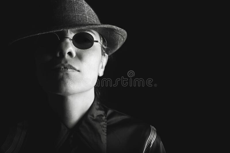 Studio portrait of man in hat and sunglasses royalty free stock images