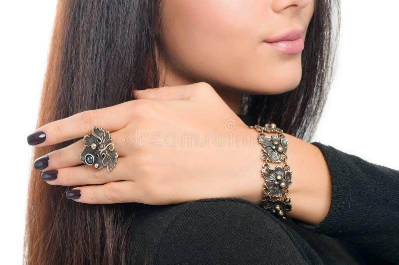 Studio portrait model wearing stylish finger ring and bracelet. royalty free stock images