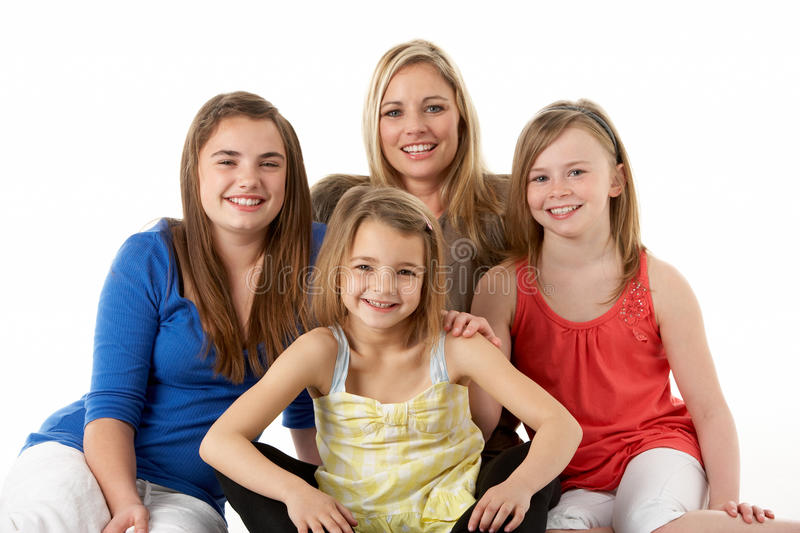 Studio Portrait Of Mother Hugging Daughters Royalty Free Stock Photography