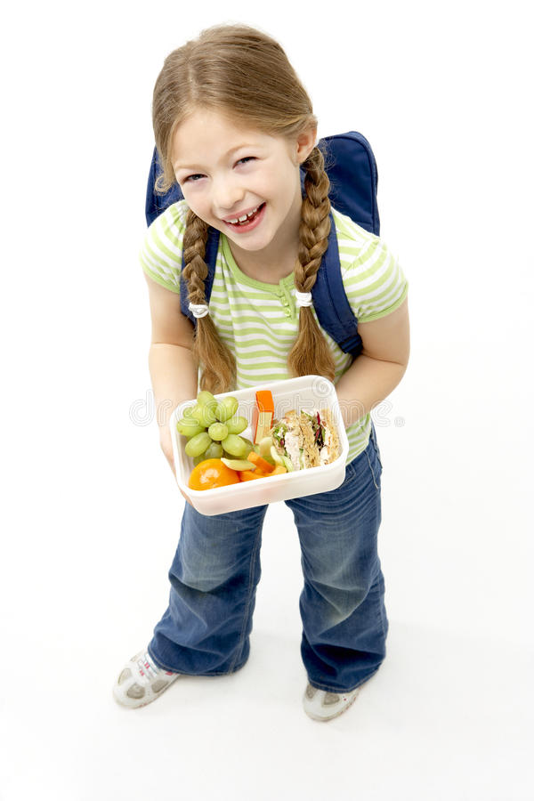 Free Studio Portrait Of Smiling Girl Holding Lunchbox Stock Images - 10970804