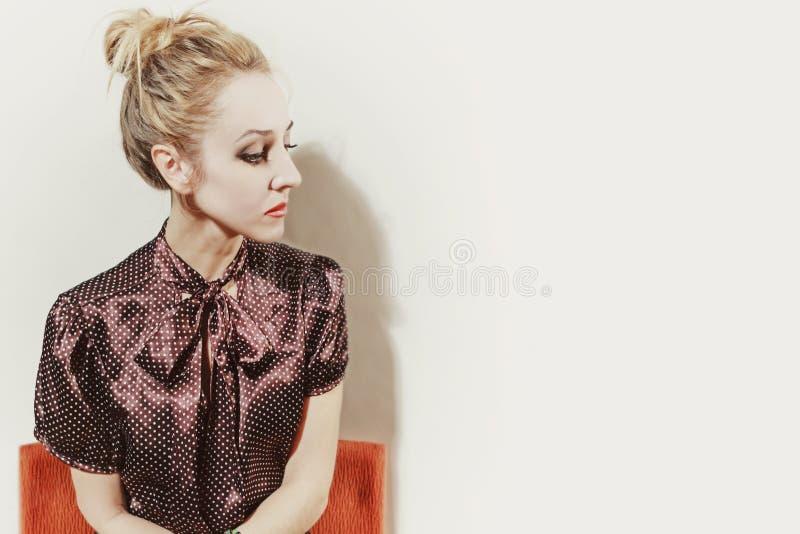 Studio portrait ofl young blonde woman stock photo