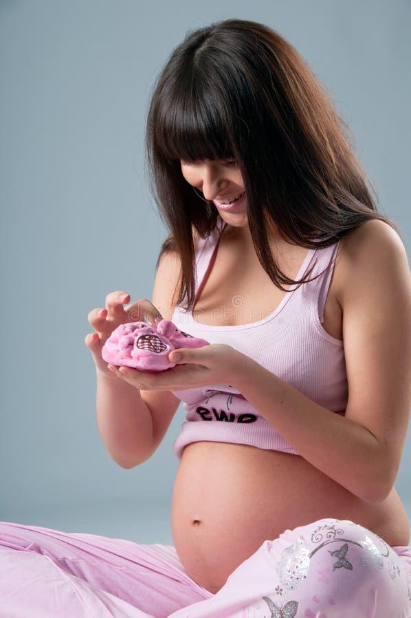 Studio portrait of pregnant woman stock photo