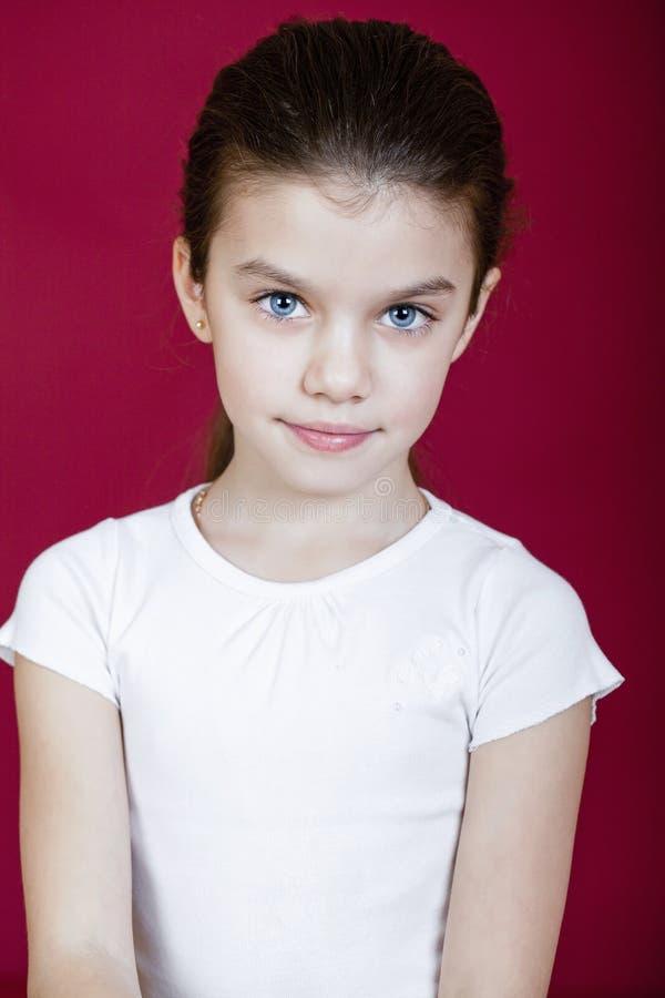 Studio portrait of a pretty little girl stock photography
