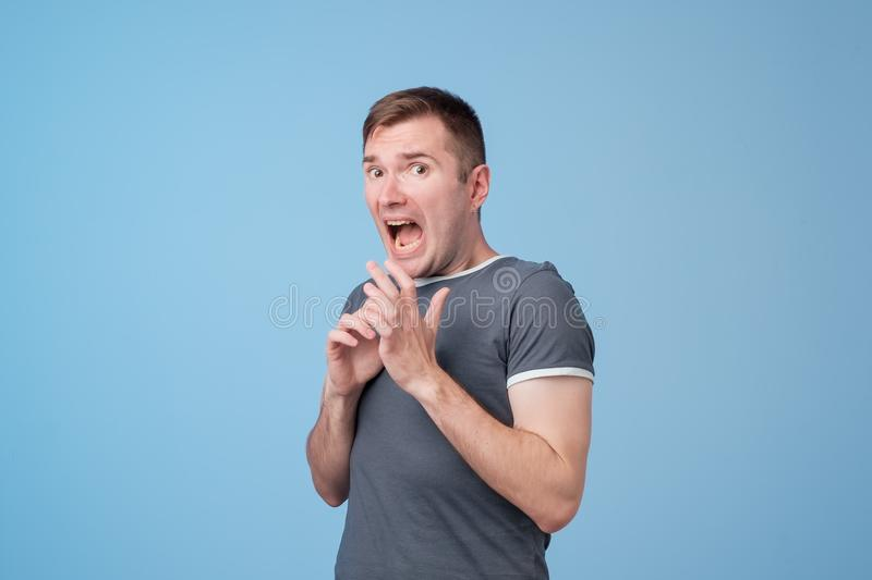 Studio portrait of scared european middle aged man. royalty free stock photos