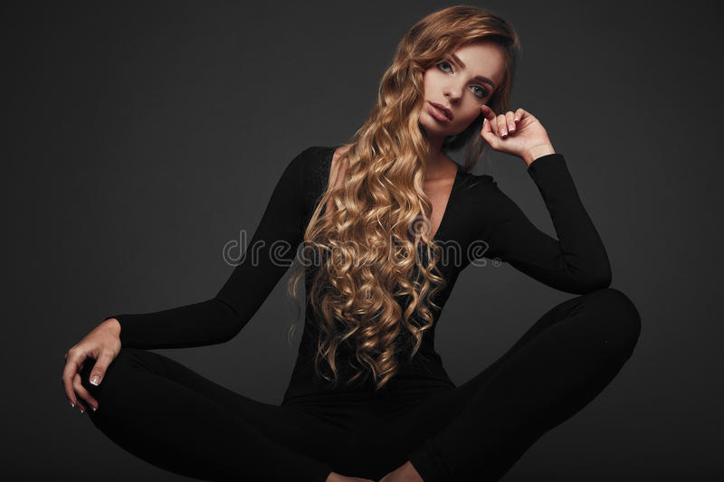 Studio portrait of a long hair blonde royalty free stock photos