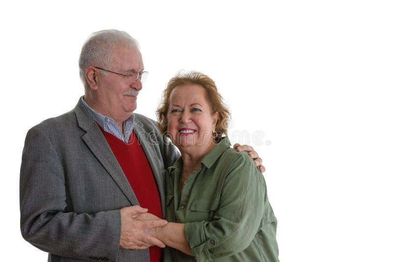 Studio portrait of cheerful senior couple royalty free stock images
