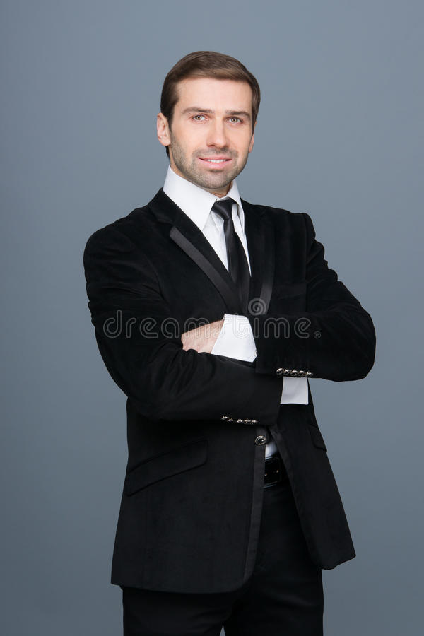 Studio portrait of a smiling fashion young businessman stock images