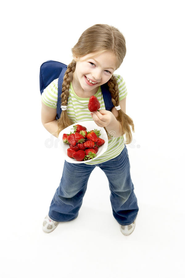 Studio Portrait of Smiling Girl Holding Bowl of St royalty free stock images