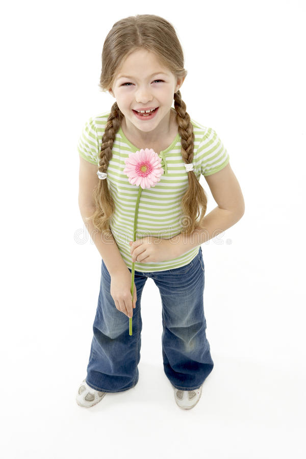Studio Portrait of Smiling Girl Holding Flower royalty free stock photo
