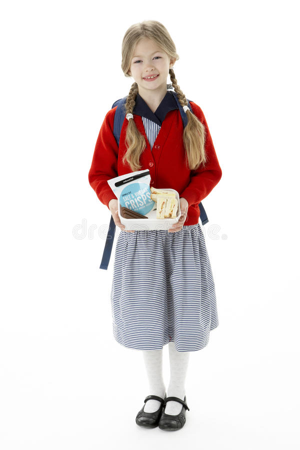 Studio Portrait of Smiling Girl Holding Lunchbox stock photo