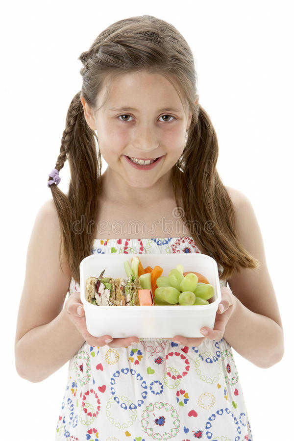 Download Studio Portrait Of Smiling Girl Holding Lunchbox Stock Photo - Image: 10970854