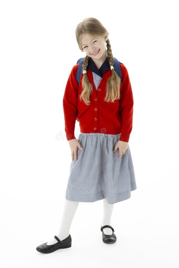 Studio Portrait of Smiling Girl Wearing School Bag royalty free stock photo