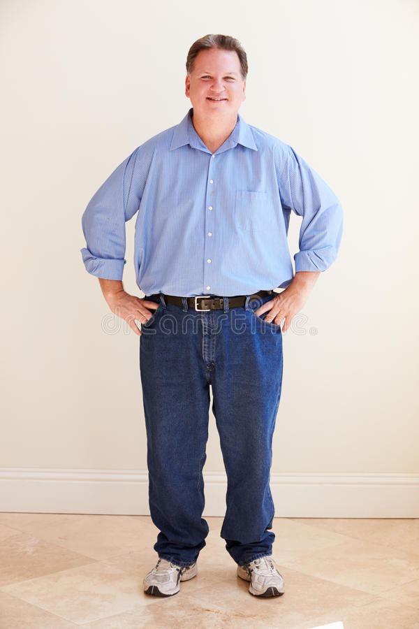 Studio Portrait Of Smiling Overweight Man royalty free stock photos