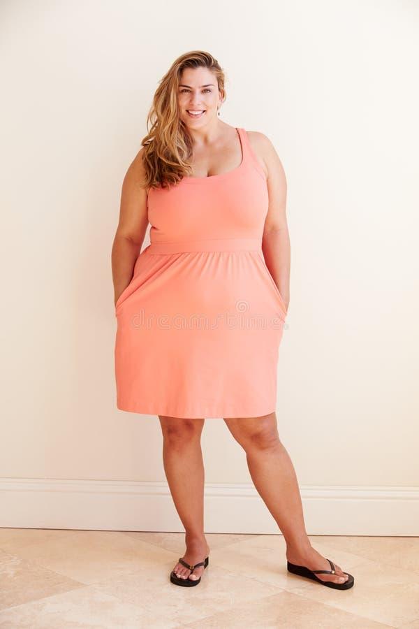 Studio Portrait Of Smiling Overweight Woman stock photo