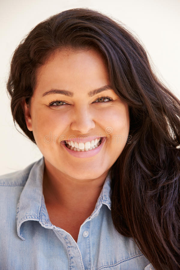 Studio Portrait Of Smiling Overweight Woman royalty free stock images