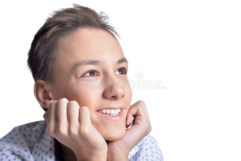 Studio portrait of smiling teenage boy on white background royalty free stock photography