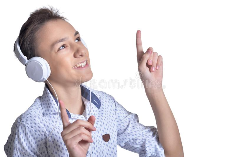 Studio portrait of teenage boy pointing up on white background stock photo