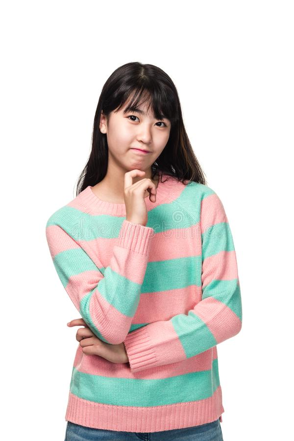 Studio portrait of teenage East Asian woman thinking stock photography