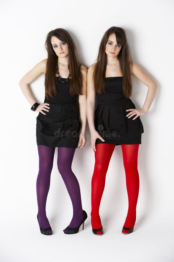 Studio Portrait Twin Teenage Girls royalty free stock photo