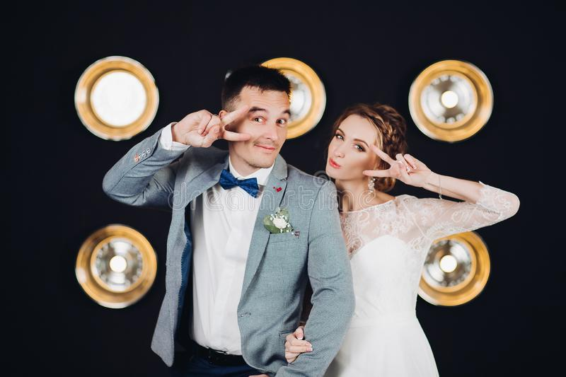 Positive wedding couple having fun and dancing at party. royalty free stock image