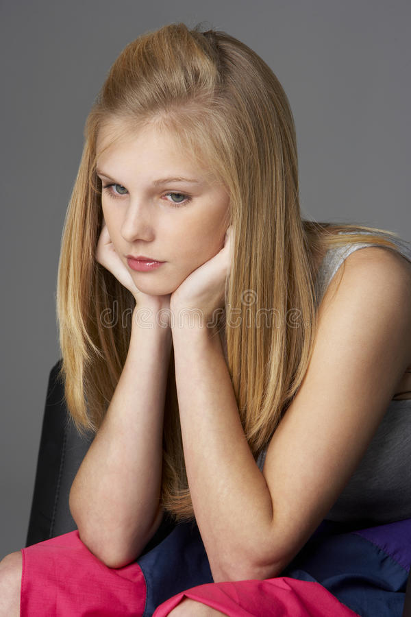 Studio Portrait Of Unhappy Teenage Girl Stock Images