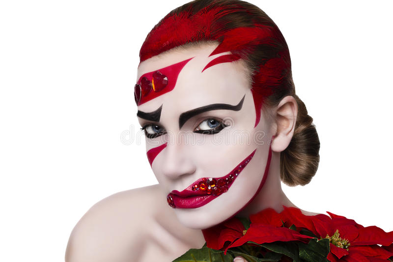 Studio portrait of a woman. Art make-up in red stock photo